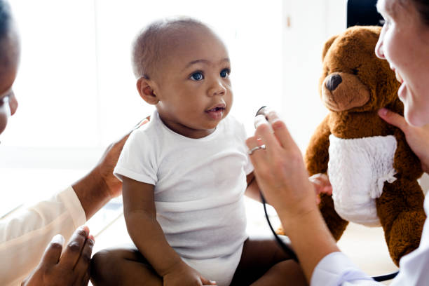 Baby visiting the doctor for a checkup stock photo