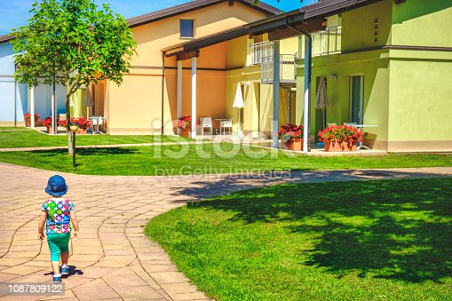 istock baby walk in the driveway to home background 1087809122