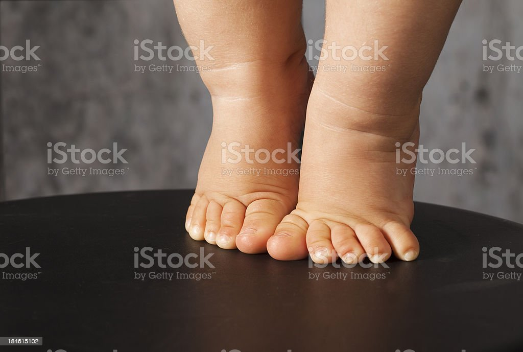 Baby walking on chair stock photo