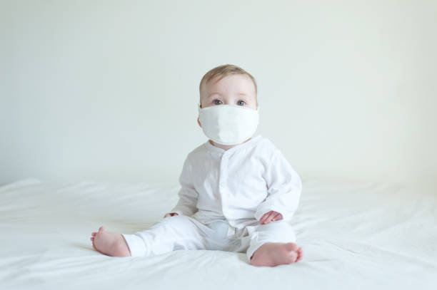 Baby Wearing a mask stock photo