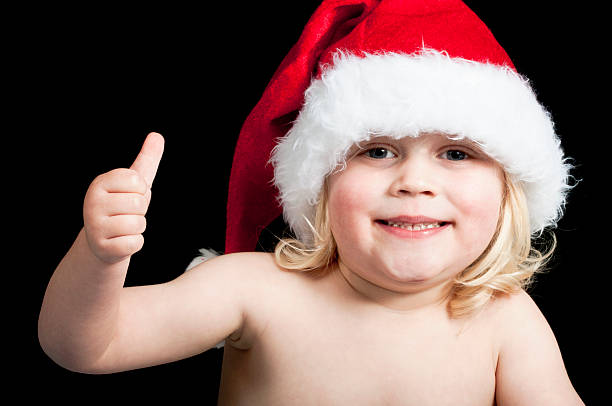 Baby wearing a santa hat stock photo