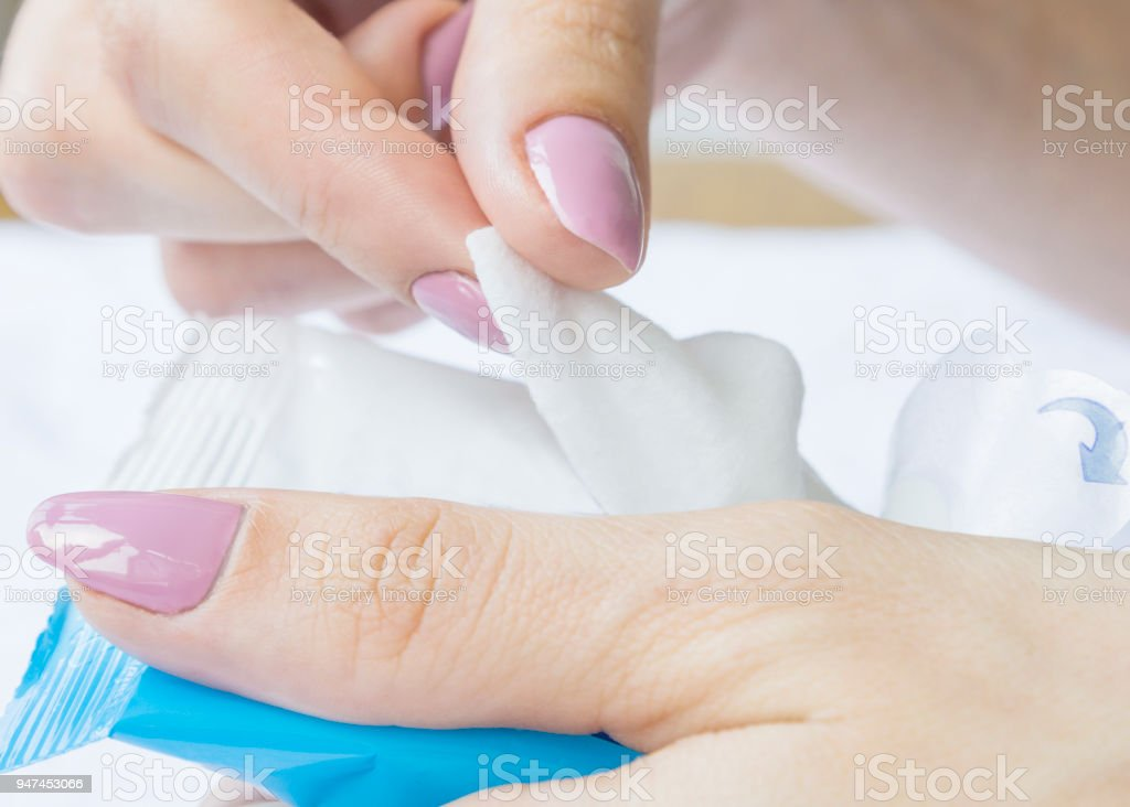 Baby wet wipes in a woman's hand. stock photo