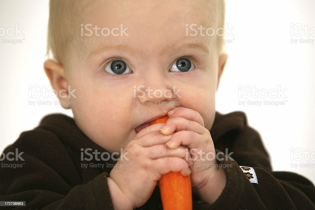 baby with a carrot royalty-free stock photo