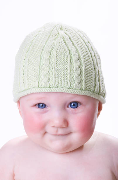 Baby with a smirk stock photo
