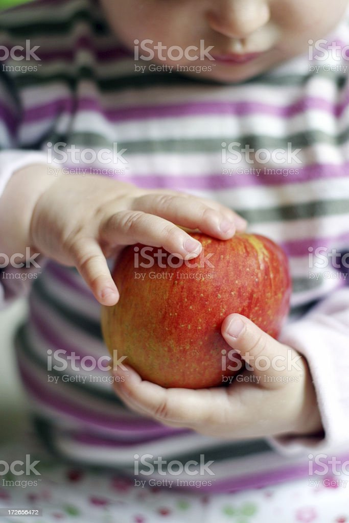 Baby with apple royalty-free stock photo