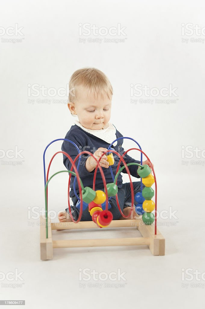 Baby With Bead Toy royalty-free stock photo