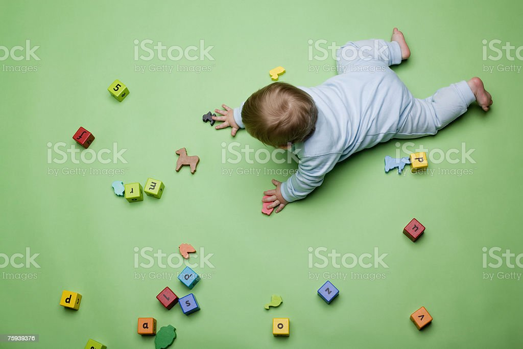 Baby with building blocks stock photo