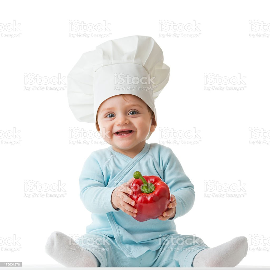 Baby with chef hat and red pepper stock photo