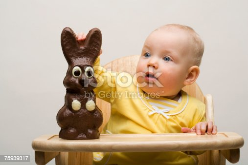 istock Baby with chocolate bunny 75939317