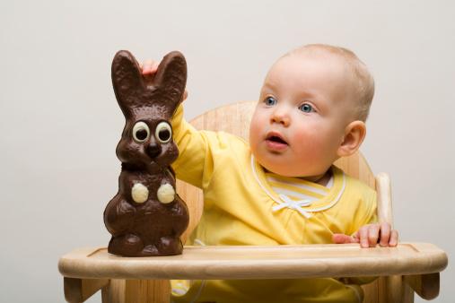 istock Baby with chocolate bunny 75939317