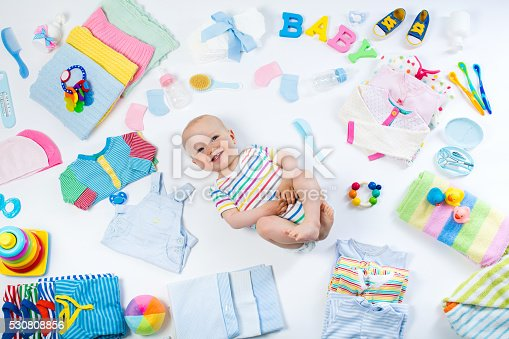 istock Baby with clothing and infant care items 530808856