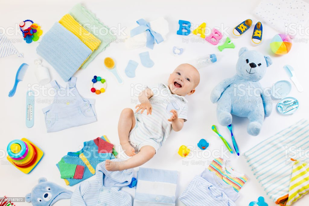 Baby with clothing and infant care items stock photo