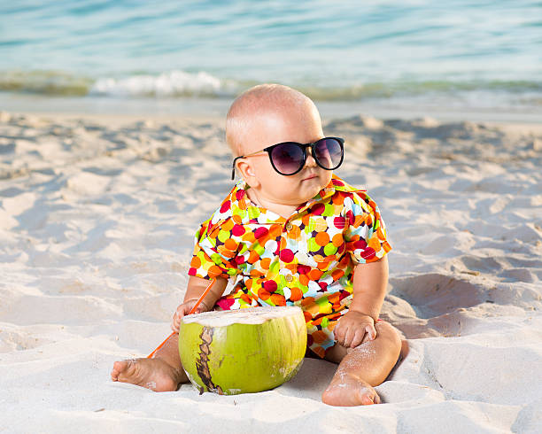 Baby with coconut stock photo