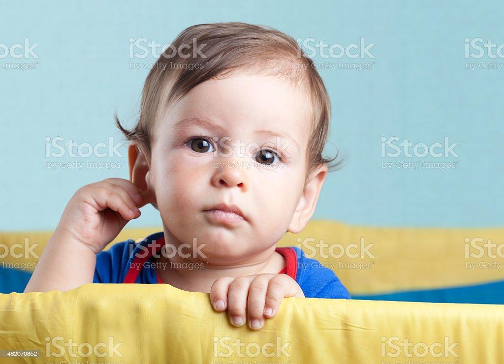 Baby with crib stock photo