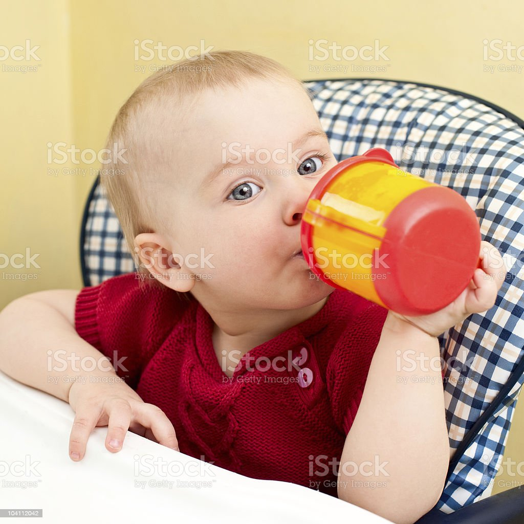 Baby with cup stock photo