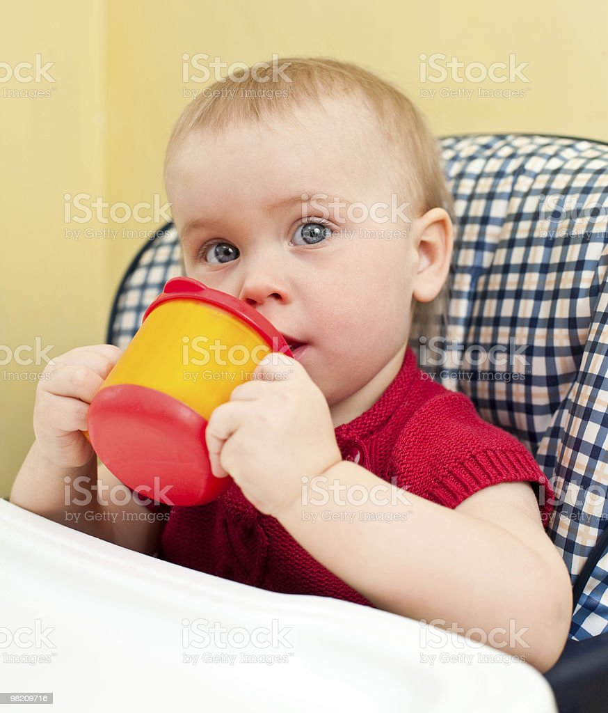 Baby with cup royalty-free stock photo