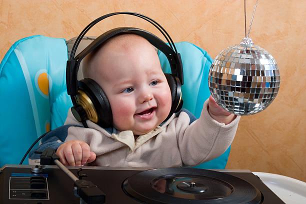 baby with disco ball stock photo