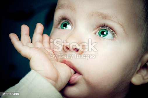 Baby girl with finger in her mouth