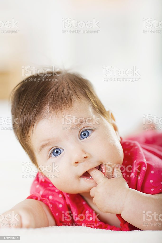 Baby with finger in her mouth royalty-free stock photo