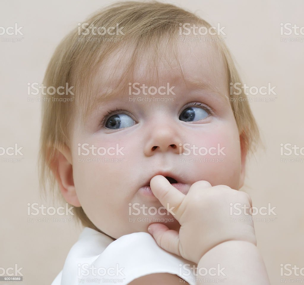 Baby with finger in mouth, looking backward royalty-free stock photo