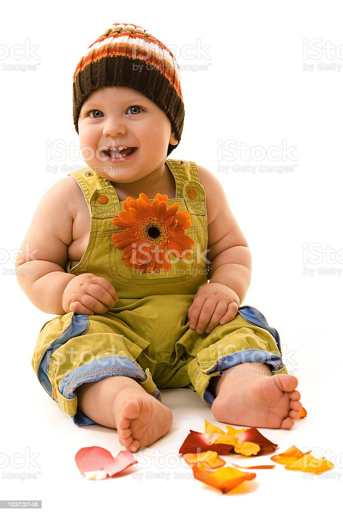 Baby with flower for Valentine's day smiling royalty-free stock photo