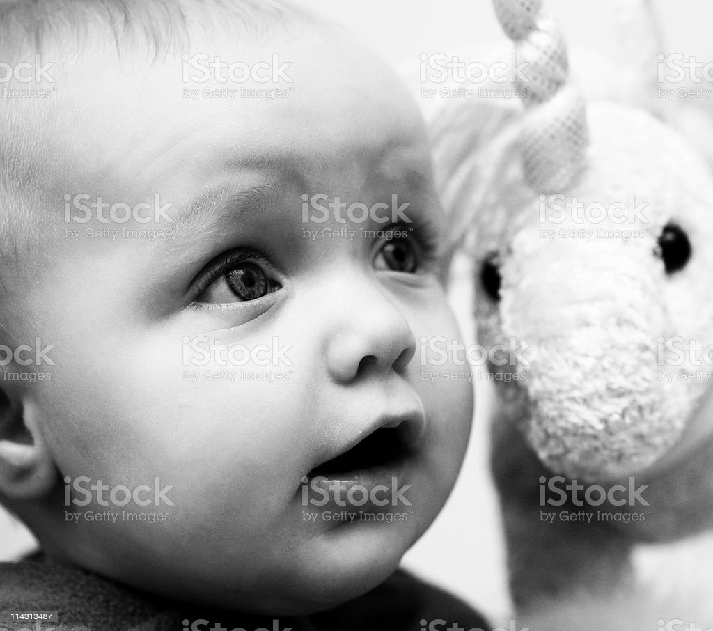 Baby with fluffy unicorn royalty-free stock photo