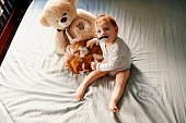 istock baby with his puppy friend enjoying at home 953459574