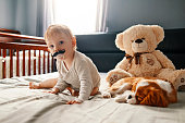 istock baby with his puppy friend enjoying at home 953459642