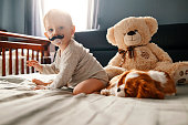 istock baby with his puppy friend enjoying at home 953553506
