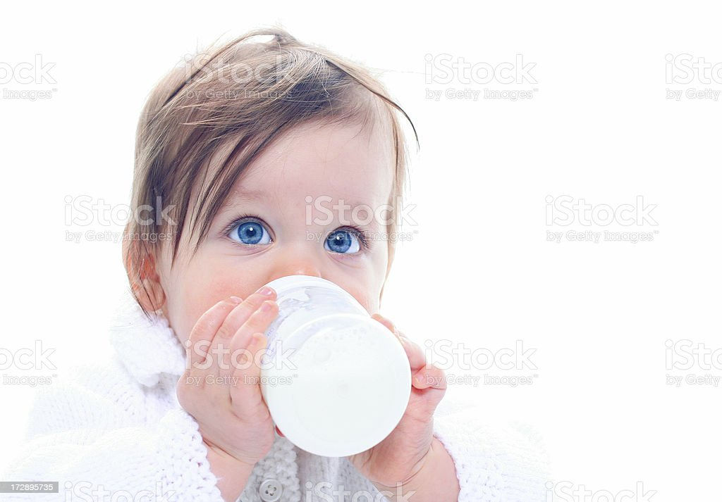 Baby with milk bottle stock photo