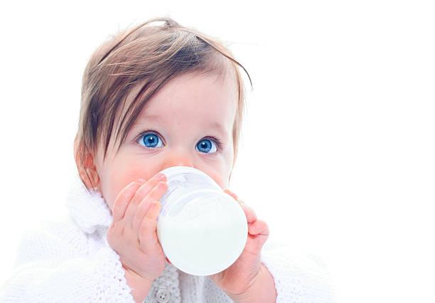 Baby with milk bottle stock photo