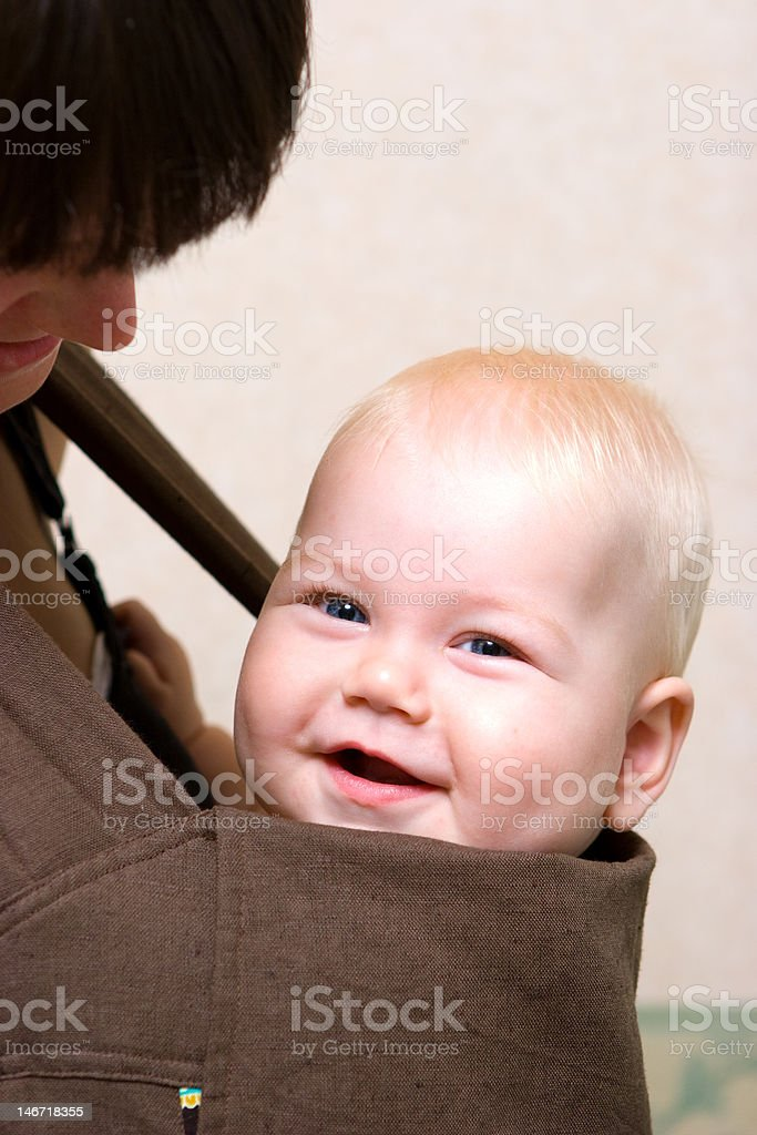 Baby with mom in sling royalty-free stock photo