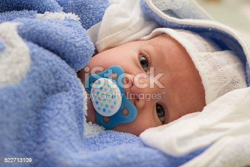 177414958istockphoto Baby with pacifier 522713109