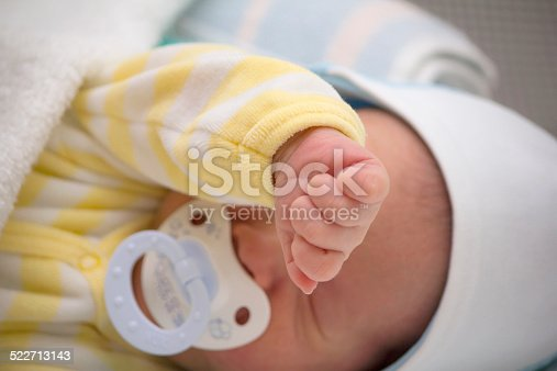 177414958istockphoto Baby with pacifier 522713143