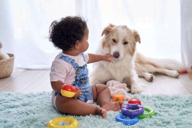 baby with pet dog at home