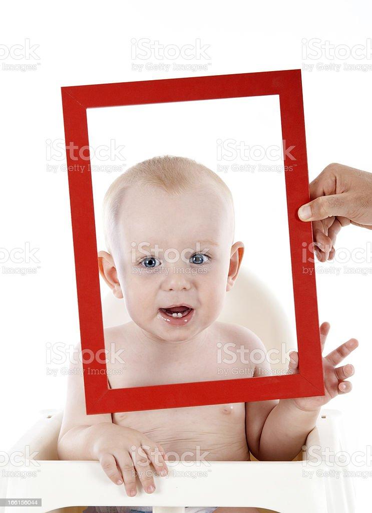Bebê com moldura de quadro - foto de acervo