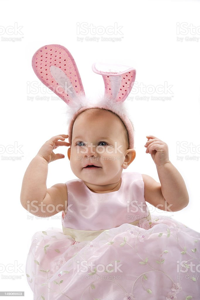 Baby with pink bunny ears royalty-free stock photo