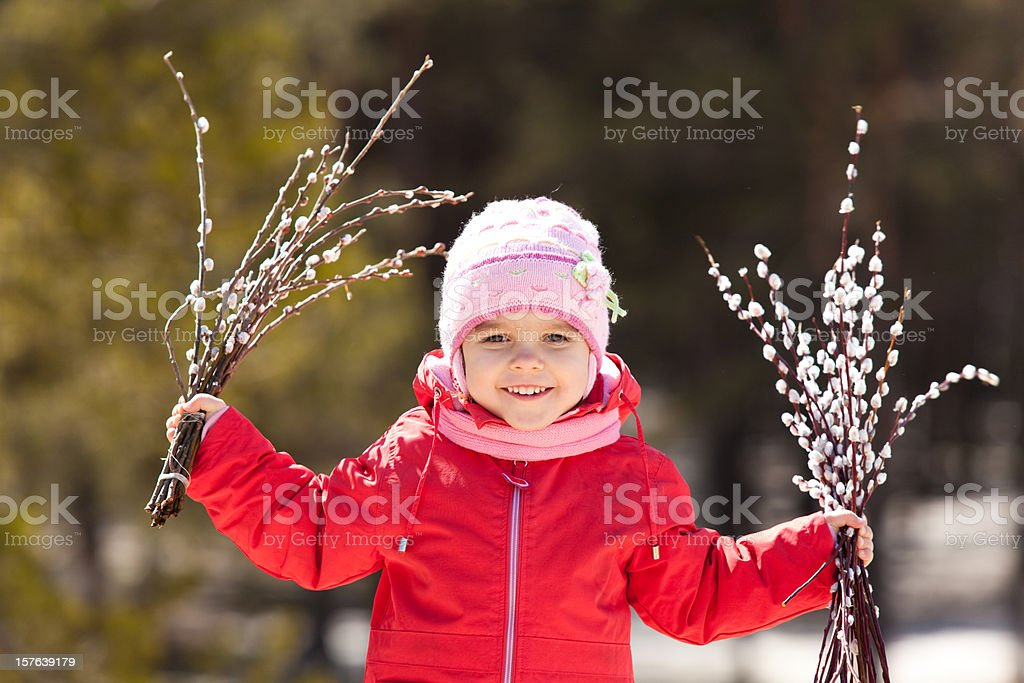 Baby with pussy willow stock photo