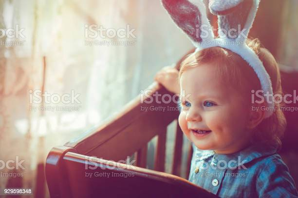 Baby with rabbit ears in easter picture id929598348?b=1&k=6&m=929598348&s=612x612&h=cjsu1zkdwbbhzrc933rqx0xqvvz14sceeha8whwnivw=
