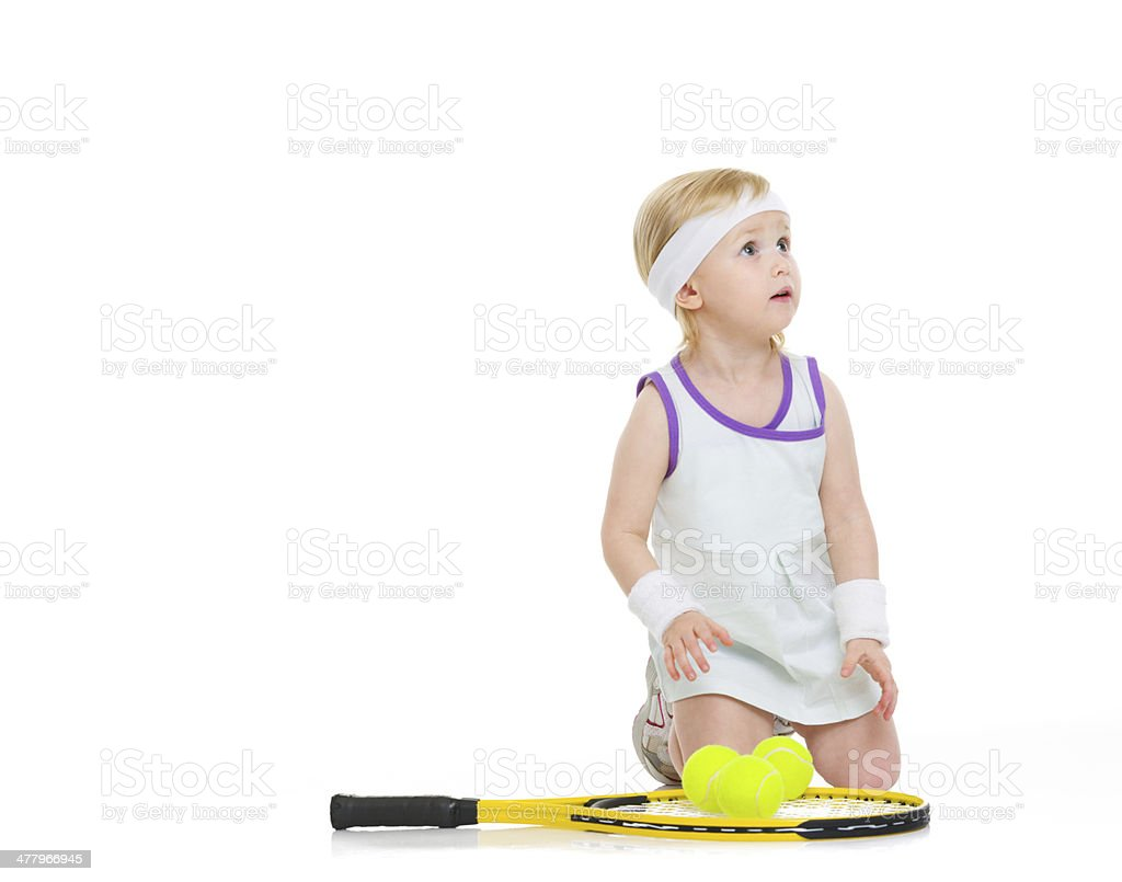 Baby with racket and balls looking on copy space royalty-free stock photo