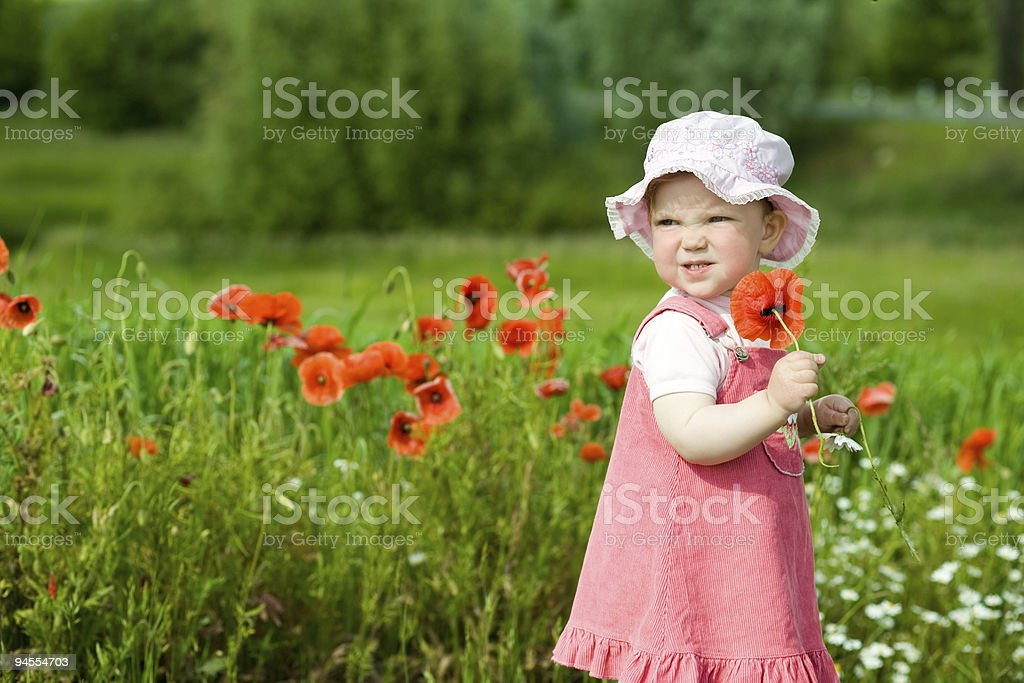 Baby with red flower royalty-free stock photo