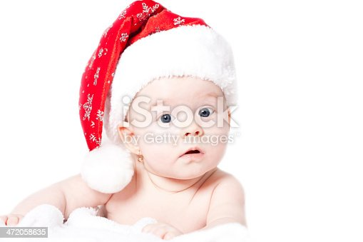 istock Baby with Santa hat isolated on white 472058635