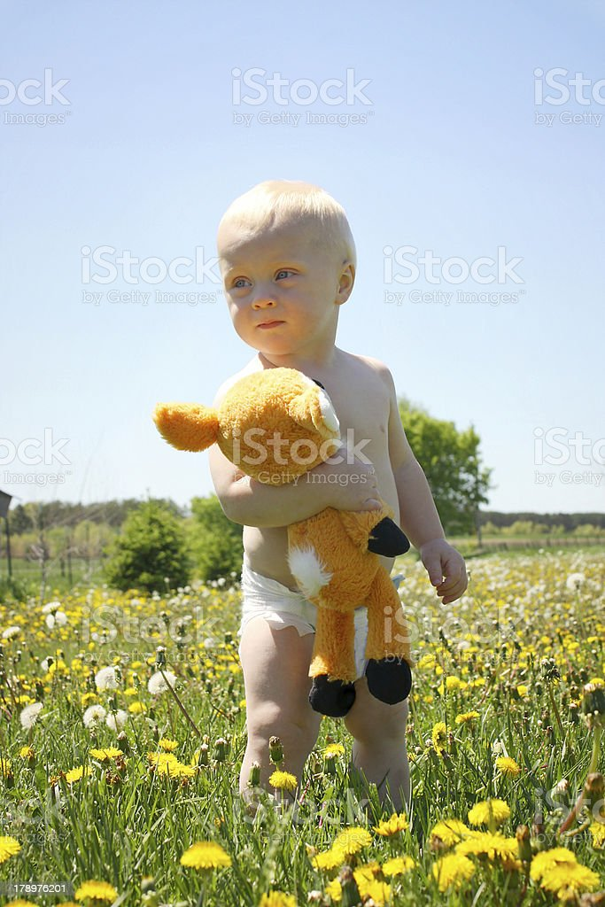 Baby with Stuffed Animal in Field royalty-free stock photo