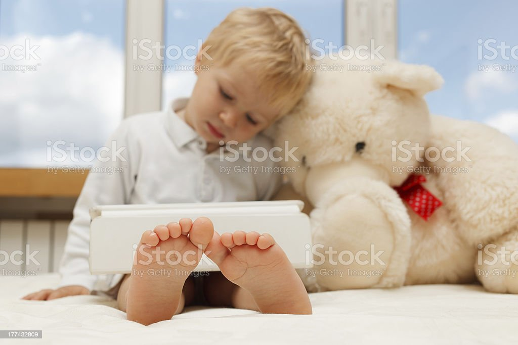 Baby with touchpad royalty-free stock photo