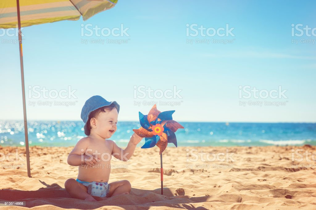 Baby with toy pinwheel stock photo