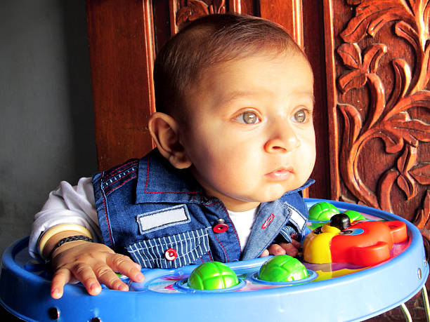 baby with walker stock photo