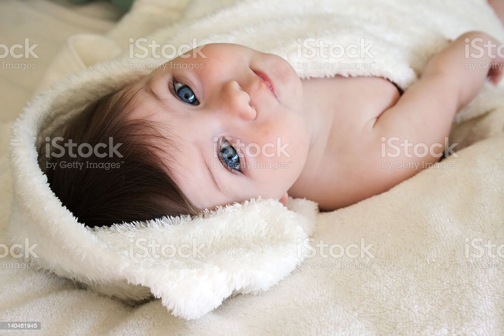 baby wrapped in white blanket royalty-free stock photo