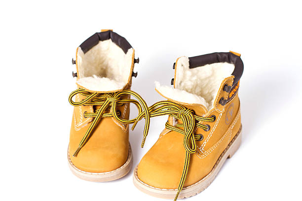 baby yellow boots - kinder winterstiefel stock-fotos und bilder