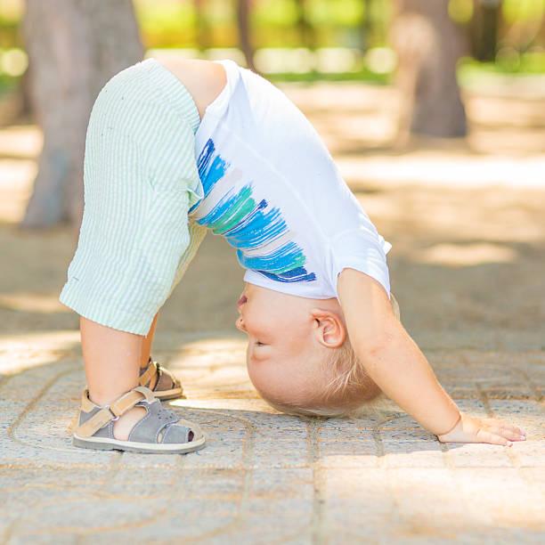 Baby yoga stock photo