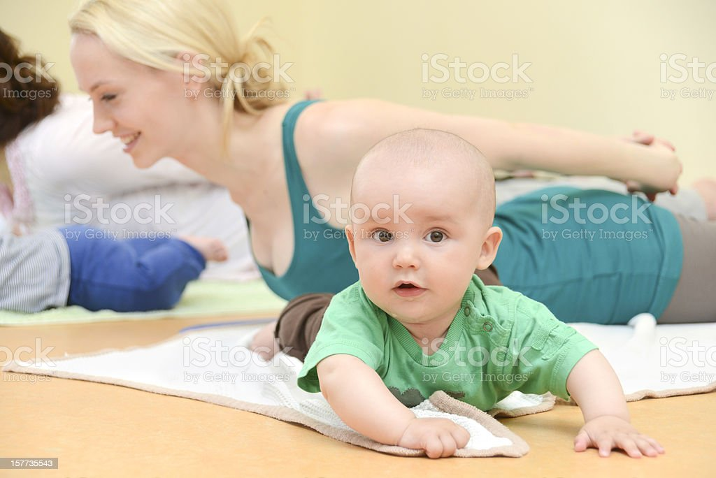 Baby Yogagroup - training with children stock photo